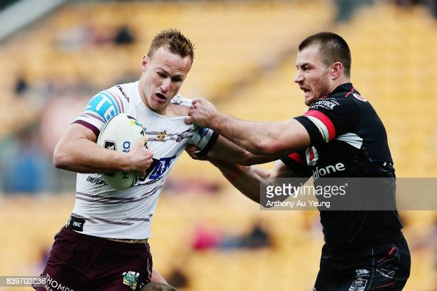 Daly CherryEvans of the Sea Eagles fends against Kieran Foran of the Warriors during the round 25 NRL match between the New Zealand Warriors and the...