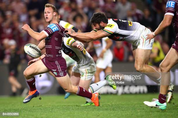 Daly CherryEvans of the Sea Eagles is tackled by James Tamou of the Panthers during the NRL Elimination Final match between the Manly Sea Eagles and...