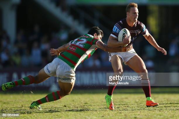 Daly CherryEvans of the Sea Eagles is tackled by Kyle Turner of the Rabbitohs during the round two NRL match between the Manly Sea Eagles and the...