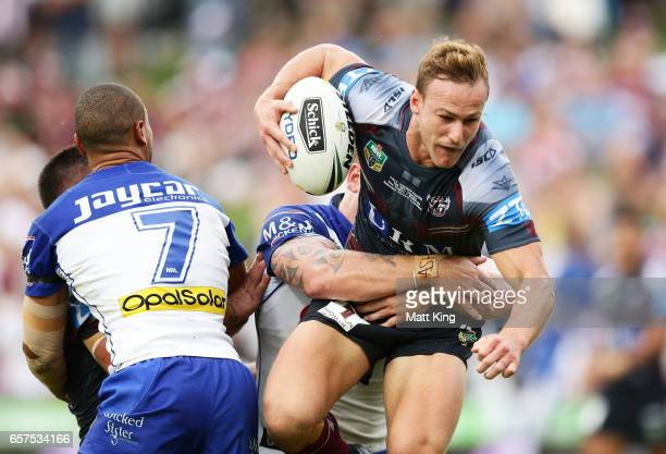 Daly CherryEvans of the Sea Eagles is tackled during the round four NRL match between the Manly Warringah Sea Eagles and the Canterbury Bulldogs at...