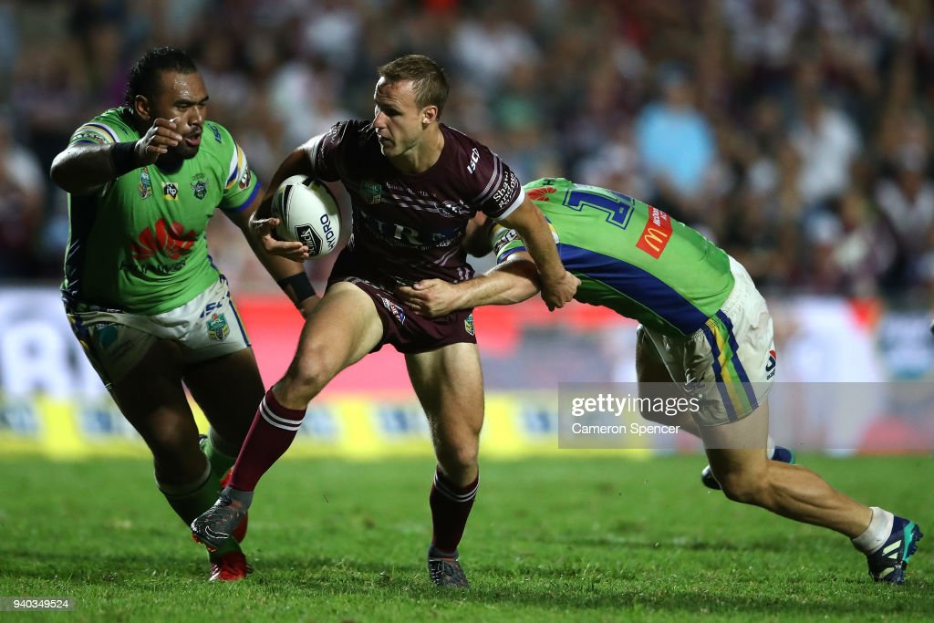 Daly Cherry-Evans of the Sea Eagles is tackled during the round four NRL match between the Many Sea Eagles and the Canberra Raiders at Lottoland on March 31, 2018 in Sydney, Australia.