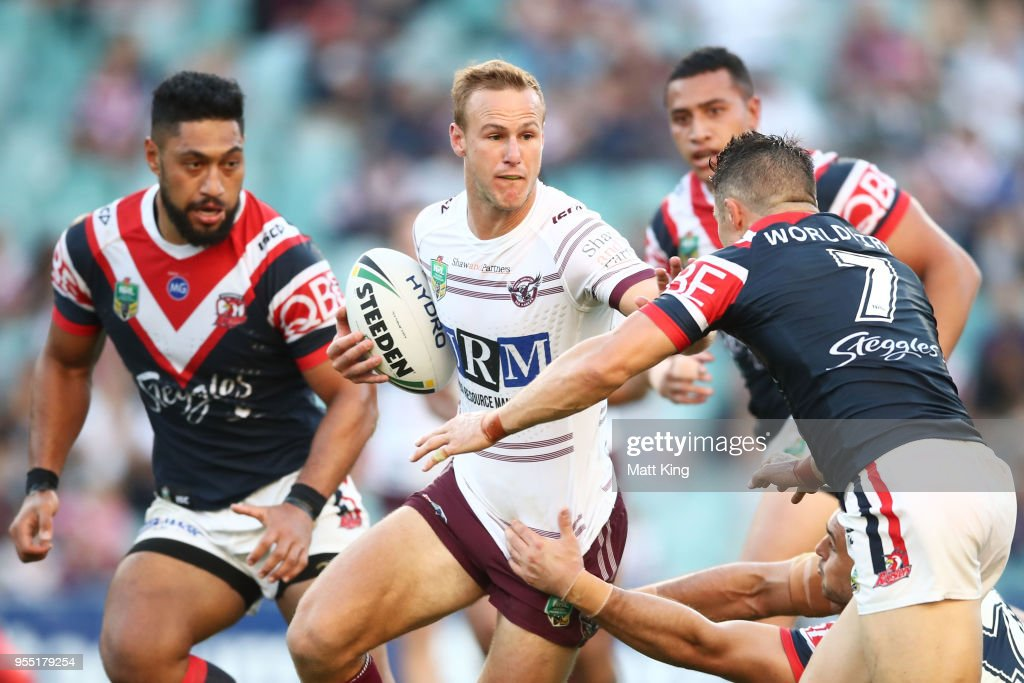 Daly Cherry-Evans of the Sea Eagles is tackled during the round nine NRL match between the Sydney Roosters and the Manly Warringah Sea Eagles at Allianz Stadium on May 6, 2018 in Sydney, Australia.