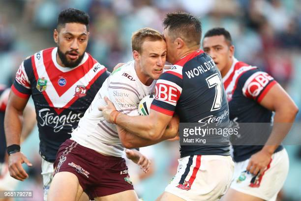 Daly CherryEvans of the Sea Eagles is tackled during the round nine NRL match between the Sydney Roosters and the Manly Warringah Sea Eagles at...