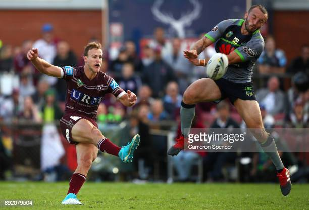 Daly CherryEvans of the Sea Eagles kicks the winning field goal in extratime during the round 13 NRL match between the Manly Sea Eagles and the...