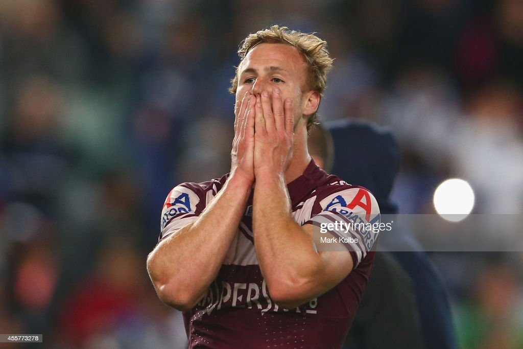 Daly Cherry-Evans of the Sea Eagles looks dejected after defeat in extra time golden point during the NRL 2nd Semi Final match between the Manly Sea Eagles and the Canterbury Bulldogs at Allianz Stadium on September 20, 2014 in Sydney, Australia.