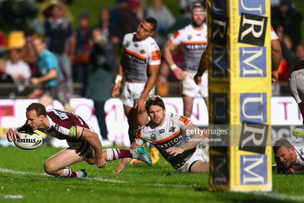 Daly Cherry-Evans of the Sea Eagles loses the ball over the tryline during the round 15 NRL match between the Manly Sea Eagles and the Wests Tigers at Brookvale Oval on June 19, 2015 in Sydney, Australia.