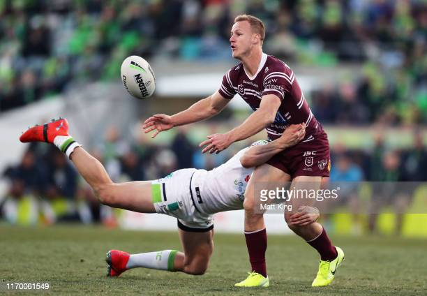 Daly Cherry-Evans of the Sea Eagles offloads the ball in a tackle during the round 23 NRL match between the Canberra Raiders and the Manly Sea Eagles...