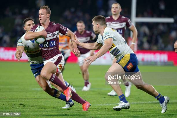 Daly Cherry-Evans of the Sea Eagles runs against a tackle during the round 22 NRL match between the Manly Sea Eagles and the Parramatta Eels at...