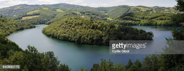 dam and lake of castelnau lassouts lake, aveyron, occitanie, france - midi pyrénées stock photos and pictures