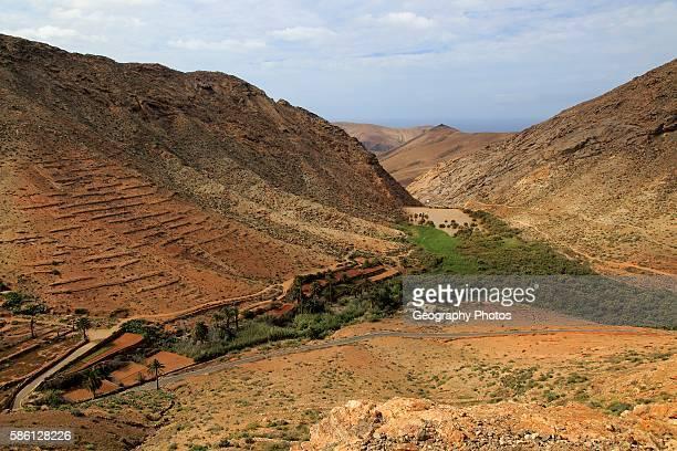 Dam and reservoir partially silted up by sediment Presa de la Penitas Fuerteventura Canary Islands Spain