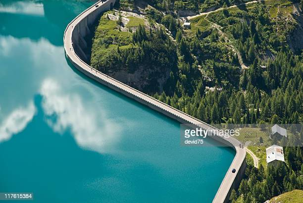 dam at end of fassa valley - energieindustrie stock-fotos und bilder