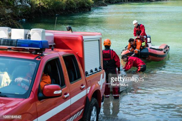 dam construction on the river - rescue operation with a boat, oil spill - rescue worker stock pictures, royalty-free photos & images