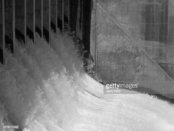 dam floodgate water outlet - hydroelectric power stock pictures, royalty-free photos & images