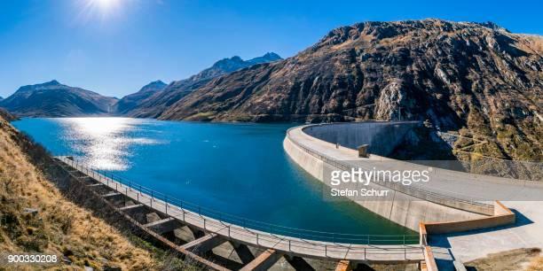 dam, lukmanier pass dam, passo del lucomagno, canton graubuenden, switzerland - stausee stock-fotos und bilder