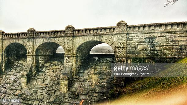 dam on lake vyrnwy against clear sky - lake vyrnwy stock pictures, royalty-free photos & images