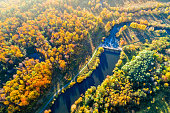 Dam on River among Trees. Bird's-eye View
