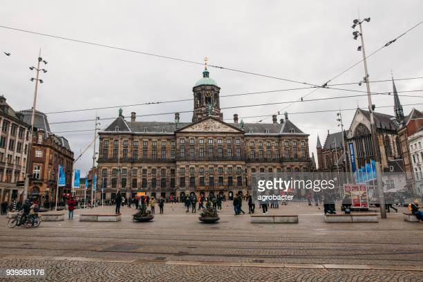 dam square, amsterdam - royal palace amsterdam stock pictures, royalty-free photos & images