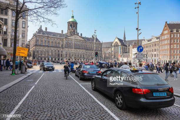Dam Square in Amsterdam a town square in the Dutch capital Dam Square is a popular historic market square in the center of the city for locals and...