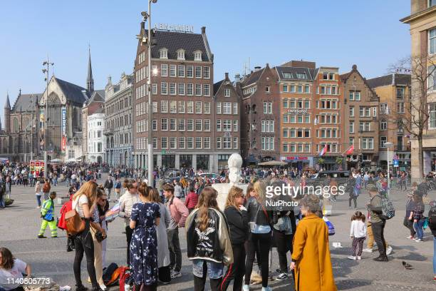 Dam Square in Amsterdam, a town square in the Dutch capital. Dam Square is a popular historic market square in the center of the city for locals and...