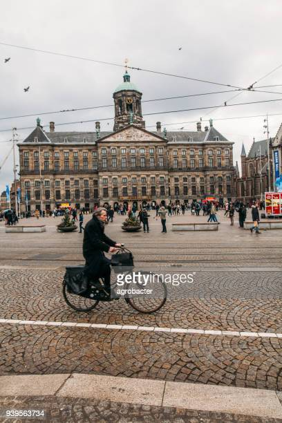 dam square in amsterdam - royal palace amsterdam stock pictures, royalty-free photos & images