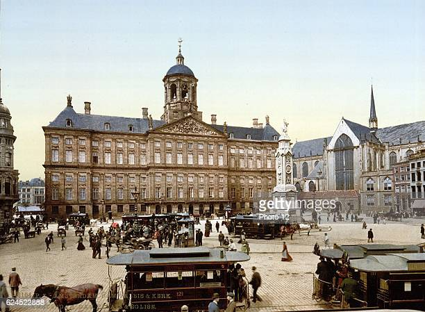 Dam Square with the Royal Palace, centre, and Nieuwe Kerk , Amsterdam, Holland. Church mainly rebuilt in Gothic style after a fire in 1645.