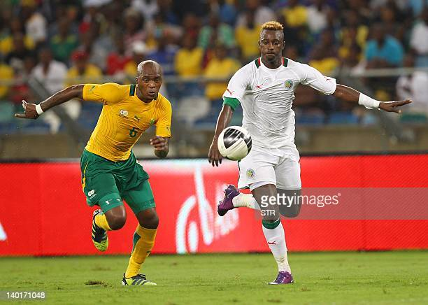 Dama Ndoye of Senegal vies with Morgan Gould of South Africa during a friendly football match between South Africa and Senegal at the Moses Mabhida...