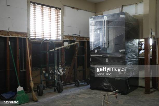 Damage and ongoing repairs resulting from Hurricane Harvey are pictured inside a home in the Meyerland neighborhood on August 25 2018 in Houston...