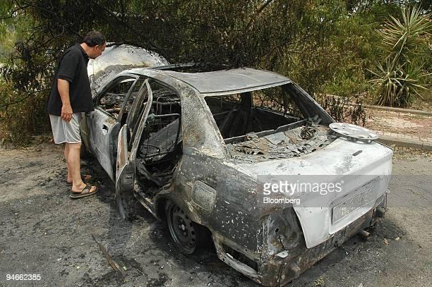Damage by rocket fire is seen in Hatzor haglilit village in northern Israel Saturday July 15 2006 Israeli warplanes struck Lebanon dozens of times...