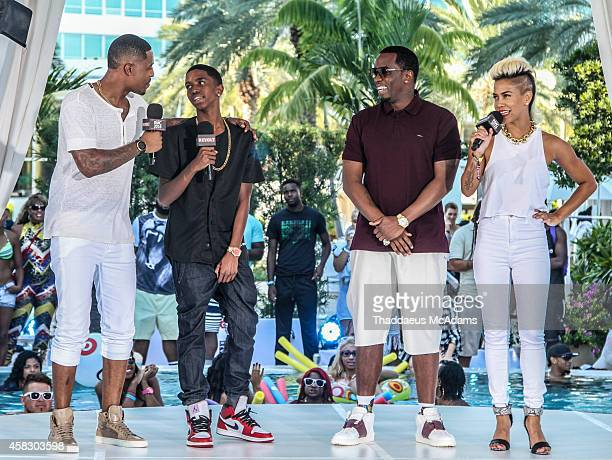 DJ Damage Christian Combs Diddy and Sib Vicious attends Revolt Music Conference at Fontainebleau Miami Beach on October 17 2014 in Miami Beach Florida