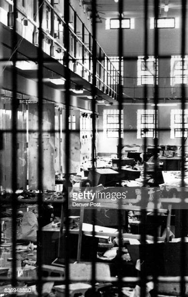 Damage Extensive in Prison Riot An armed guard watches as Warden Jerry Griffin tours cell blocks at the New Mexico State Penitentiary Monday...