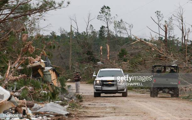Damage from a tornado which killed at least 23 people is seen as Lee county deputies secure the scene in Beauregard Alabama on March 4 2019 Rescuers...