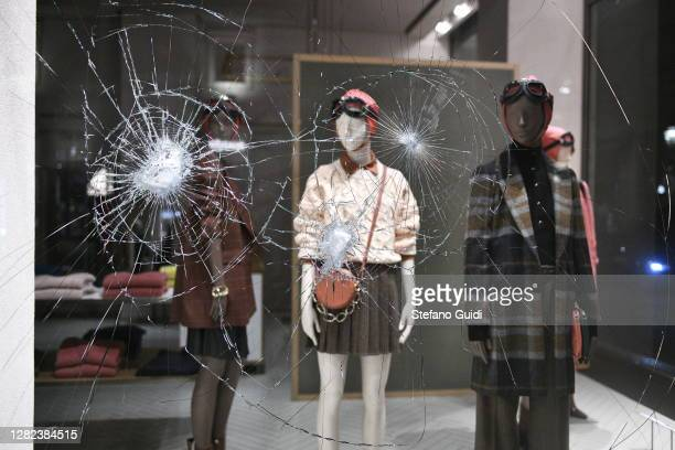 Damage is seen after demonstrators clash with Riot Police during the protest against the lockdown in Piazza Castello on October 26, 2020 in Turin,...