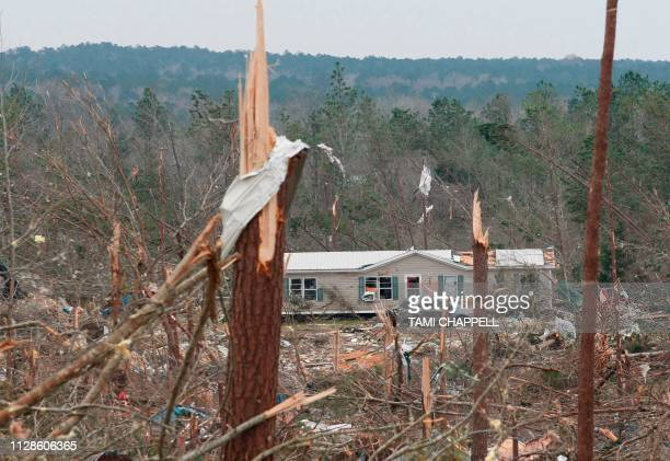TOPSHOT Damage is seen from a tornado which killed at least 23 people in Beauregard Alabama on March 4 2019 Rescuers in Alabama were set to resume...