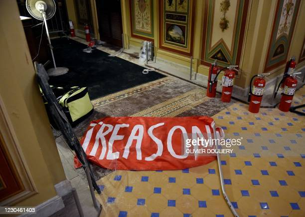 Damage is seen inside the US Capitol building early on January 7, 2021 in Washington, DC, after supporters of US President Donald Trump breeched...