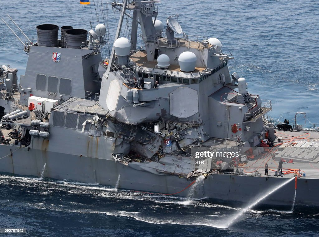 TOPSHOT - Damage is seen on the guided missile destroyer USS Fitzgerald off the Shimoda coast, after it collided with a Philippine-flagged container ship, on June 17, 2017. Seven US sailors were missing and a skipper injured after their Navy destroyer collided with a container ship off the coast of Japan early on June 17, with the badly damaged US vessel partially flooded. / AFP PHOTO / JIJI PRESS / STR / Japan OUT