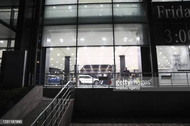 Damage is seen on the windows of an auto showroom at the Gulan Street after two rockets landed inside the Erbil International Airport, which has a...