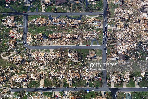 Damage is seen one day after a tornado tore through Joplin killing at least 122 people on May 24, 2011 in Joplin, Missouri. The tornado that ripped...