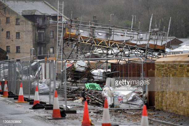 Damage is seen to a scaffolded structure beside the River Calder as residents begin clearing up following severe flooding beside the River Calder on...