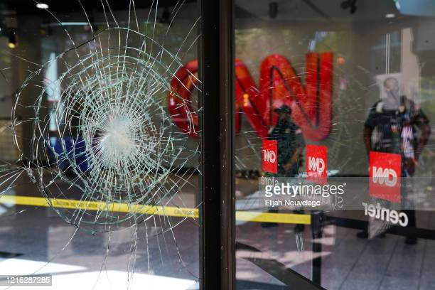 Damage is seen to CNN Center following an overnight demonstration over the Minneapolis death of George Floyd while in police custody on May 30 2020...