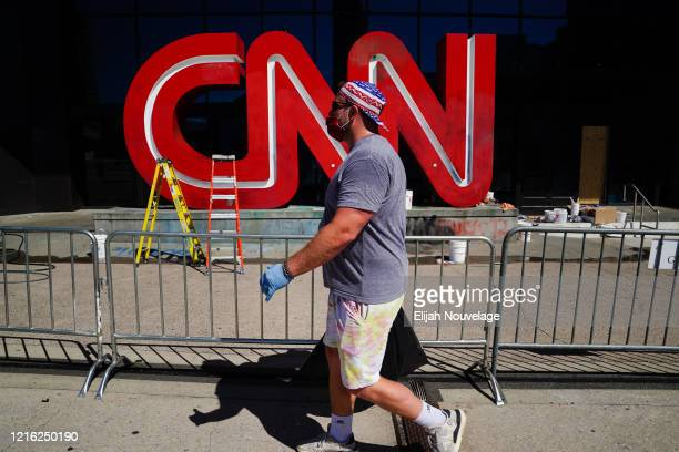 Damage is seen to the CNN logo following an overnight demonstration over the Minneapolis death of George Floyd while in police custody on May 30,...