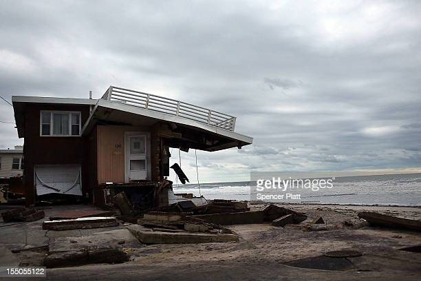 Damage is viewed in the Rockaway neighborhood where the historic boardwalk was washed away during Hurricane Sandy on October 31, 2012 in the Queens...