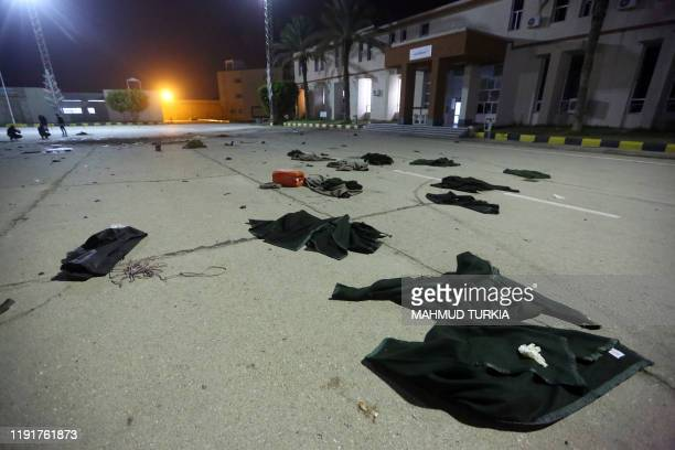 Damage on the concrete and clothing, from an air strike earlier in the day, is seen at a Military College in Al-Hadaba region in the Libyan capital...