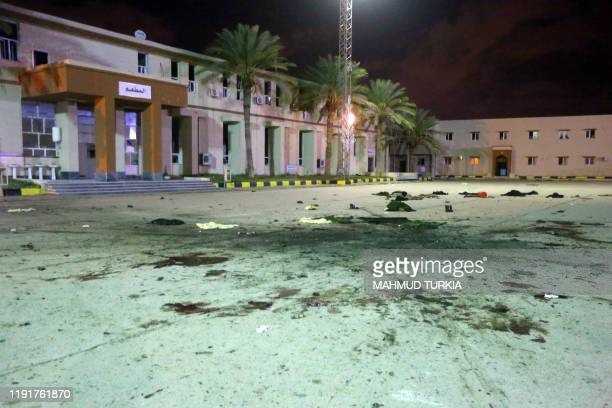 Damage on the concrete, from an air strike earlier in the day, is seen at a Military College in Al-Hadaba region in the Libyan capital Tripoli, on...