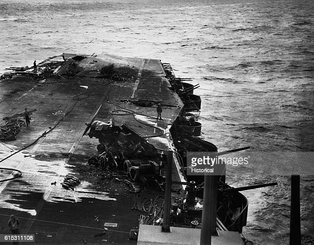Damage sustained by the USS Saratoga results from Japanese airplane attacks at Iwo Jima Volcano Islands View of the flight deck after the fires have...
