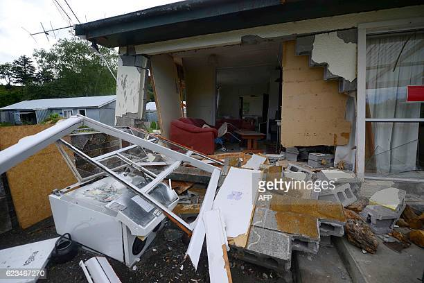 Damage to a house is seen in Waiau town some 80 kms to the south of Kaikoura on November 16 after an earthquake hit New Zealand on Monday Warships...