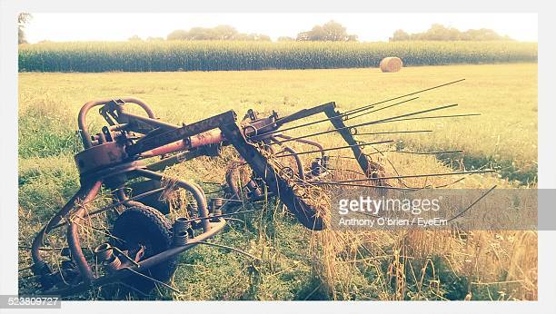 damaged agricultural machinery on field - fermoy stock photos and pictures