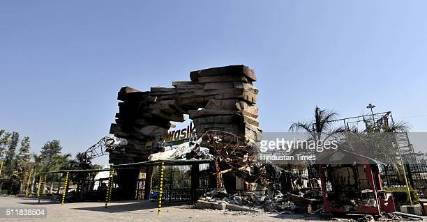 A damaged Amusement park on National Highway 1 at Murthal town after Jat protests for reservation in government services turned violent on February...