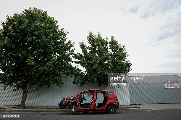 A damaged and stripped car sits outside of a salvage lot in Compton California US on Tuesday June 30 2015 It can be a letdown for LA Hood Life Hip...