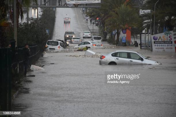 Damaged and stucked vehicles are seen in a flooded road following a torrential rain in southwestern resort district Bodrum Mugla Turkey on November...