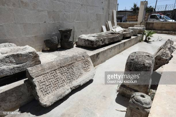 Damaged architect are seen at the Idlib Museum after it reopened on August 13 2018 in the northern Syrian city of Idlib An antiquities museum in...